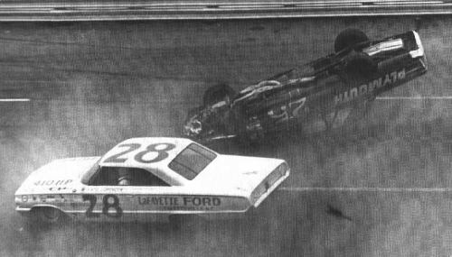 Freddy Lorenzen goes by a crashing Paul Goldsmith in '64 Atlanta 500