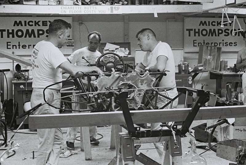 Mickey Thompson's crew spent long hours in the Indy garage in May trying to get his racer to handle properly