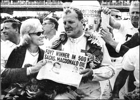 1964 Indy 500 winner AJ Foyt holds newspaper about Dave MacDonald and Eddie Sachs death