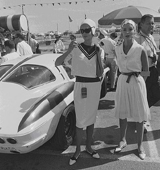 "Riverside race beauties pose for photos near Dave's futuristic looking new Corvette Stingray�> </p>       <p>A little more than an hour before the race and the Chevrolet camp stops by for a word with Cobra driver Billy Krause. Mickey Thompson<br>(kneeling), Zora Duntov & Elfi Duntov (hat) and Dave MacDonald in between the Duntovs. Photo Dave Friedman <p><img name="""" src="