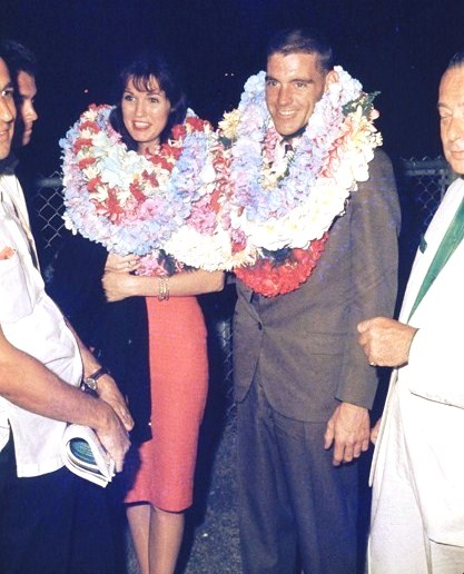 Racer Dave MacDonald and wife Sherry with Hawaiian Grand Prix race officials 1963