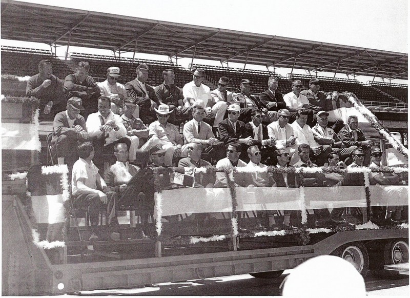 Dave MacDonald and Eddie Sachs seated next to one another in 1964 Indy 500 drivers photo